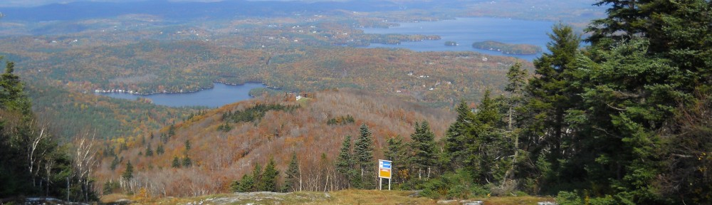 Fall foliage view of Lake Sunapee from atop Mt. Sunapee