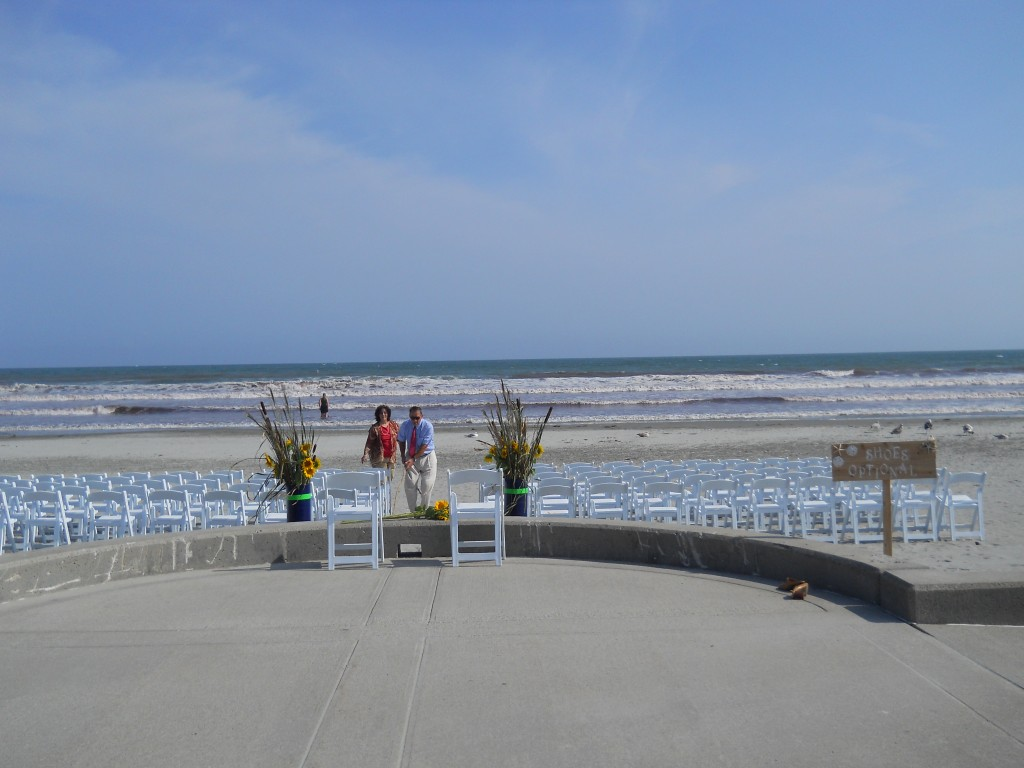 Setting up for a beach wedding in Newport.