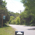 Entrance sign to Lyman Reserve from Head of the Bay Road.
